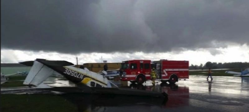 PHOTO COURTESY AURORA FIRE DEPARTMENT - Two planes were reported flipped by the tornado that struck the Aurora Airport Thursday afternoon.