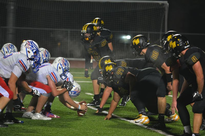 SPOTLIGHT PHOTO: JAKE MCNEAL - St. Helens' Jacob Klein (42), Dylan Lobby (56), Caleb Carter (76), Caden Willaby (77), Ethan Armstrong (60), Dylan Kessinger (4) and St. Helens attempt to block La Salle Prep freshman Ian Carver's 27-yard third-quarter field goal.