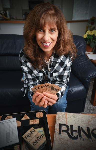 OUTLOOK PHOTO: JOSH KULLA - Gresham resident Sue Penniman and her sons created from scratch a new board game. Assembled in Gresham, 'Rhino' is a game of skill, strategy and chance.