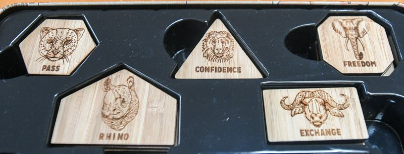 OUTLOOK PHOTO: JOSH KULLA - Five animal tokens made from bamboo give 'Rhino' players different scoring abilities.