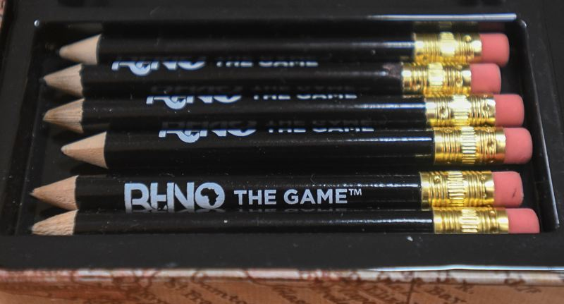 OUTLOOK PHOTO: JOSH KULLA - The various game components for 'The Rhino Game' are manufactured in different countries around the world and shipped to the Penniman home in Gresham.