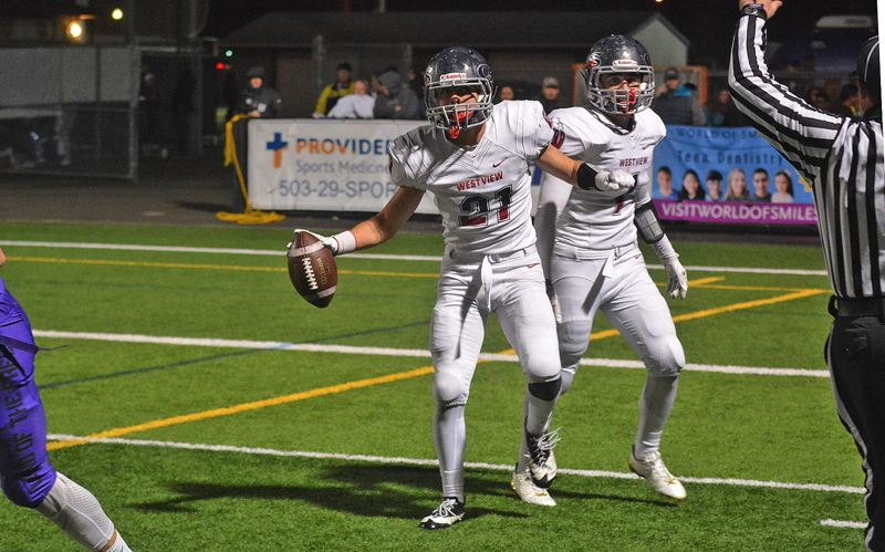 TIMES PHOTO: MATT SINGLEDECKER - Westview senior cornerback Patrick Maddox celebrates an interception against Sunset.