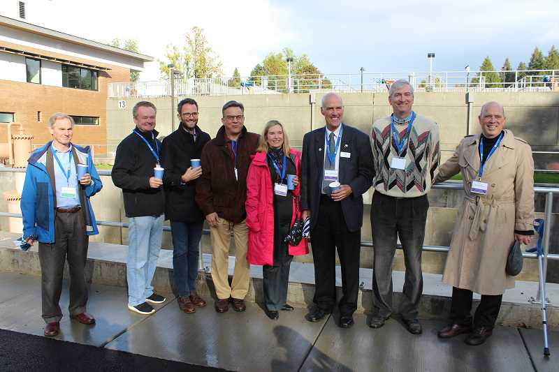 REVIEW PHOTO: ANTHONY MACUK - From left: Lake Oswego City Manager Scott Lazenby celebrates the completion of the Lake Oswego-Tigard Water Partnership with City Councilors Skip ONeill, Joe Buck, John LaMotte, Jackie Manz, Mayor Kent Studebaker, Councilor Jeff Gudman and former Mayor Jack Hoffman.