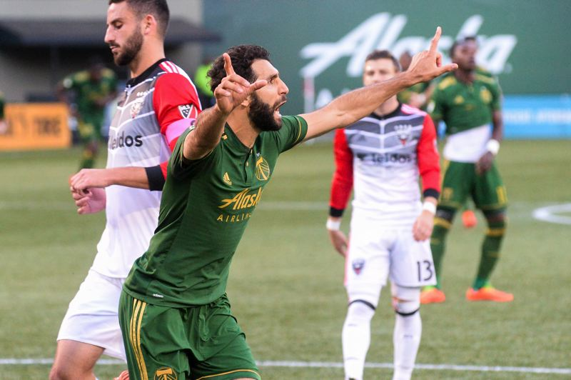 TRIBUNE PHOTO: JOSH KULLA - Diego Valeri of the Portland Timbers is happier than D.C. United as he scores on a penalty kick late in the first half on Sunday.