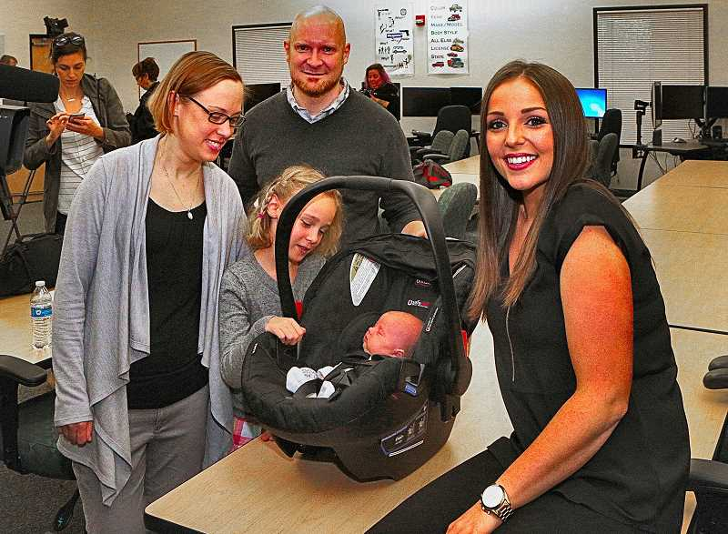 DAVID F. ASHTON - Here together: Sellwoods Sara Andersen, sister Keira Andersen admiring baby Celia, and dad Andy Loso, along with BOEC Senior Dispatcher Caitlynn Brown, who came to the rescue on the phone at a critical moment.