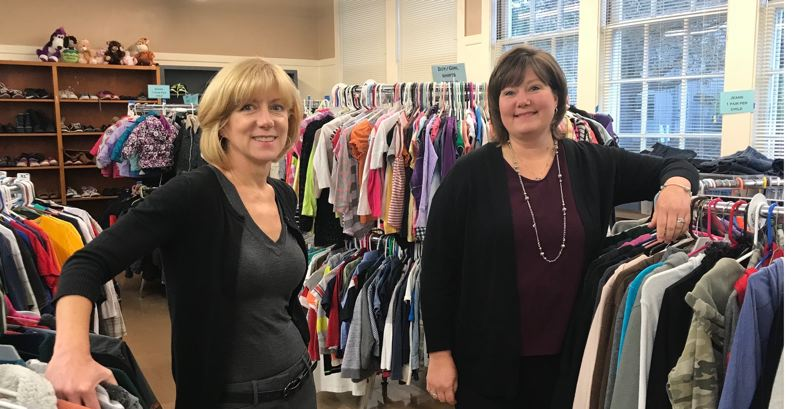 SUBMITTED PHOTO - Mary Ellen Winterhalter (left) and Julie Baumann are pictured at the Clackamas County Clothes Closet/Resource Center in the old Barclay Elementary School on 12th Street in Oregon City.