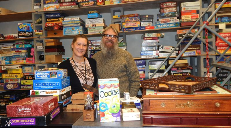 TIMES PHOTO: BARBARA SHERMAN - Carol Mathewson, left, and husband Kyle Engen own the Interactive Museum of Gaming and Puzzlery (IMOGAP), which relocated to King City from Beaverton last month.