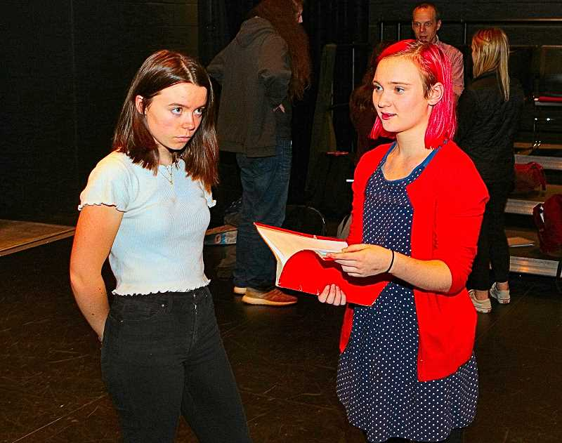 DAVID F. ASHTON - Comparing scenes in their upcoming production of Hamlet, in which they both portray Ophelia, are FHS student actors Lucy Walker and Natalie Perkins.