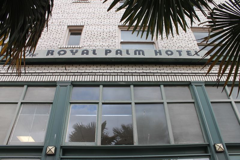 TRIBUNE PHOTO: LYNDSEY HEWITT - The Royal Palm Hotel, constructed in 1913, will be boarded up while the city considers what to do with it. The Portland Housing Bureau wants to open it back up for shelter during winter. Insert: How it used to look.
