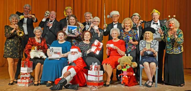 RON TENISON/NORTHWEST SENIOR THEATRE - Northwest Senior Theatre's cast members say they have fun performing with the troupe, which is evident in this cast photo of the upcoming 'It's Christmas Time' show on the stage of the Alpenrose Dairy Opera House.