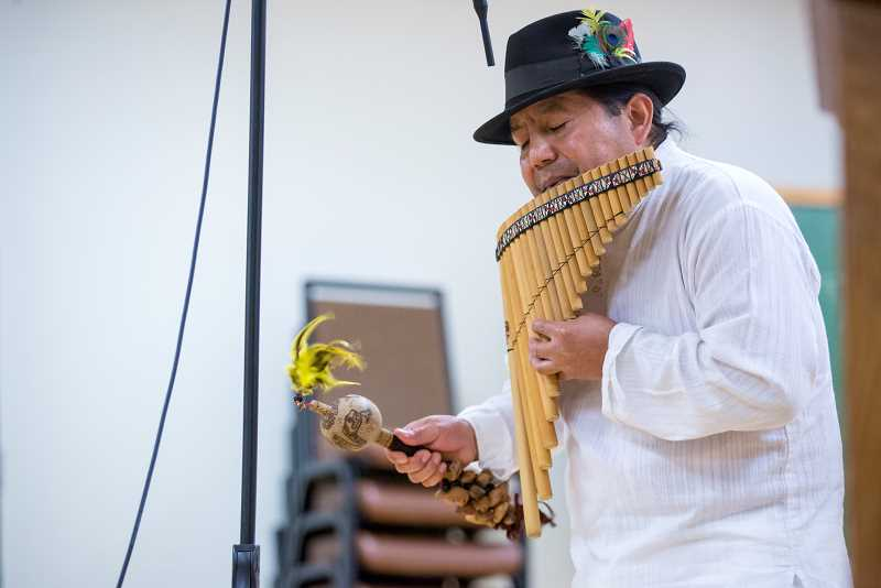 TIMES PHOTO: JONATHAN HOUSE - Felix Chuma Pinguil performs on the pan flute during the Indigenous Peoples Day Celebration at the Elsie Stuhr Center.