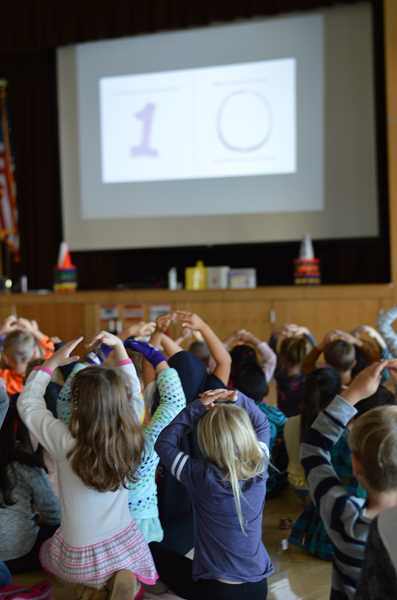 SPOKESMAN PHOTO: CLARA HOWELL - Kathryn Otoshi's presentation engages about 600 Lowrie Primary students.