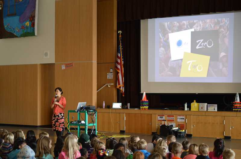 SPOKESMAN PHOTO: CLARA HOWELL  - Kathryn Otoshi speaks to students about bullying and the need to stand up for one another.