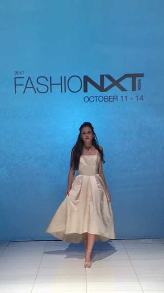 CONTRIBUTED PHOTO - Kendall Shanklin models a gown by designer Julie Danforth.