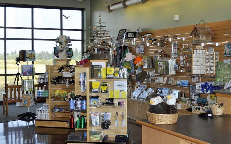 COURTESY OF TUALATIN RIVER NATIONAL WILDLIFE REFUGE - The Nature's Overlook gift store in the Tualatin River National Wildlife Refuge Visitors Center is chock-full of gifts connected to nature for those wanting to get a jump-start on their holiday gift shopping. (Note the bird outside the window aiming for a closer look at all the treasures.)