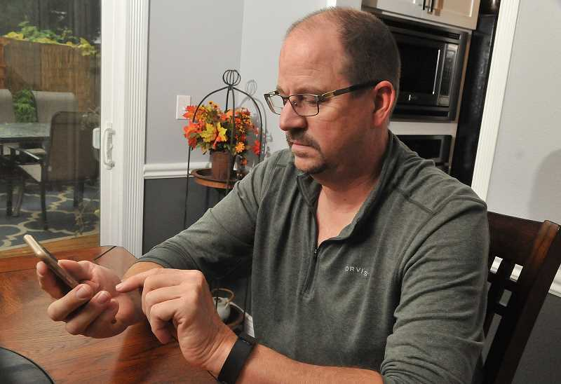 SPOKESMAN PHOTO: VERN UYETAKE - After living in Wilsonville for three years, Richard Bilger has put time and money into making his cellular service work for his family.