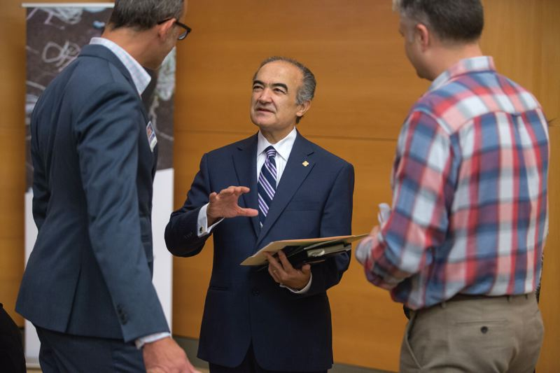 TRIBUNE PHOTO: JONATHAN HOUSE - PSU President Rahmat Shoureshi chats with attendees at a conference during a campus tour on Friday.