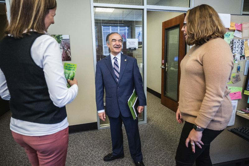 TRIBUNE PHOTO: JONATHAN HOUSE - Portland State president Rahmat Shoureshi chats with Dr. Michele Toppe, Dean od Student Life, left, and Student Conduct and Care administrative assistant Erica Geller during a campus tour on Friday.