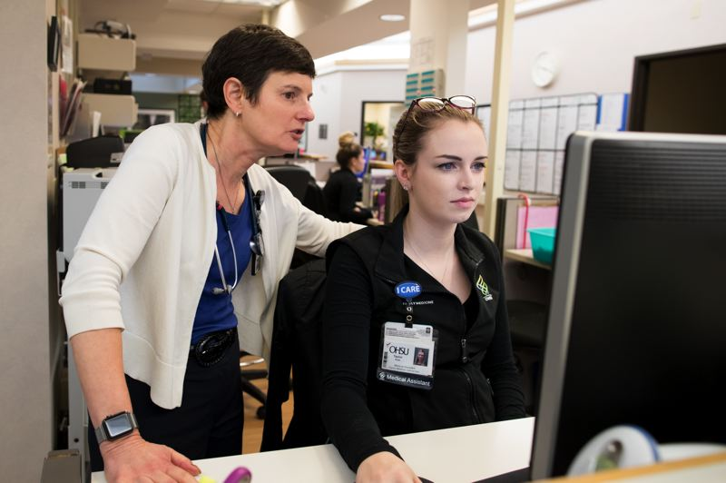 TIMES PHOTO: JAIME VALDEZ - Dr. Elizabeth Steiner Hayward looks at a patient's file with medical assistant Taylor Roth at OHSU Family Medicine, Gabriel Park.