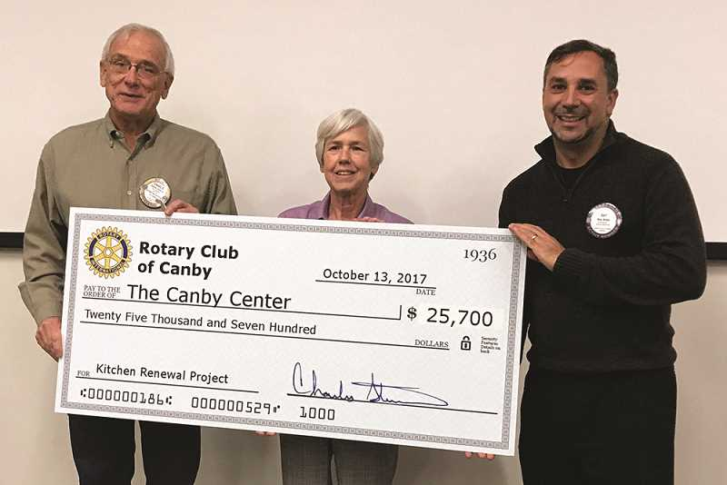 """SUBMITTED PHOTO - Of the total, $6,500 in gifts were matched by Clackamas Federal Credit Union and Gingerich Farms Products, Inc.  The Rotary Club has contributed or raised $36,417 to date for The Canby Center's kitchen project.The Canby Center's kitchen has been used to provide nearly 1,000 meals and redistribute more than 84,000 pounds of food to the homeless and low-income families in the last 12 months.  Still, the kitchen is in poor shape and needs serious attention according to Executive Director Ray Keen.  """"People who are facing life's challenges often feel hope slipping through their fingers,"""" said Keen. """"We want to create a space where our guests have 'kitchen table' conversations and are strengthened in their dignity.  The Rotary Club of Canby is helping us do just that.""""The remodel of the kitchen is designed to facilitate a 25 percent increased availability of hot lunches for those with immediate needs, and a 20 percent improved collection and distribution of food for families and to support healthy cooking classes.The total cost of the project is estimated at $135,000, with $84,896 raised to date.  Construction is anticipated to begin in December 2017. Anyone interested in supporting the project can give at https://thecanbycenter.org/donate/ or by calling 503-266-2920."""