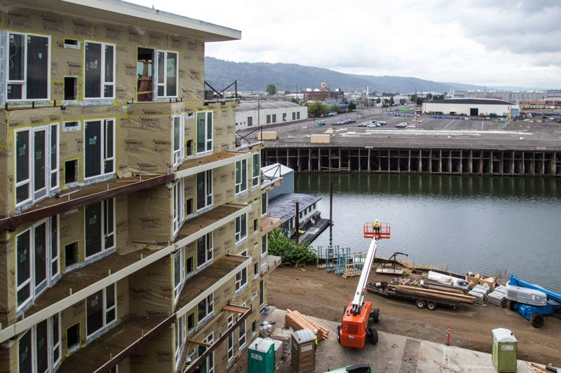 TRIBUNE FILE PHOTO - Residential construction near Portland's waterfront continues as the economy hums along.