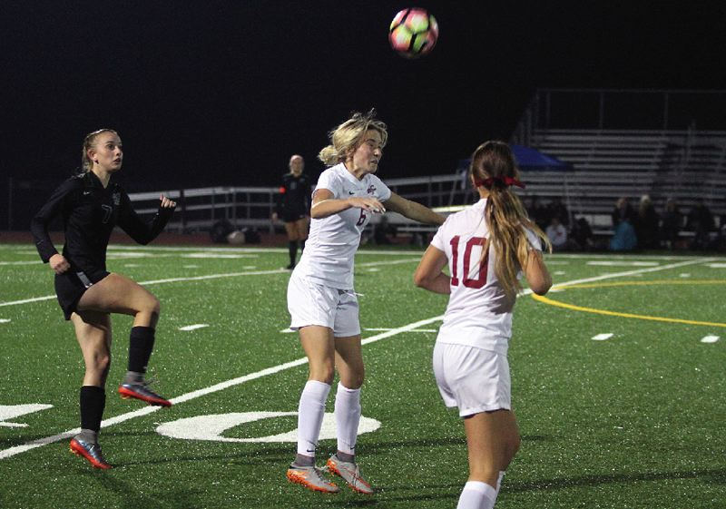 PAMPLIN MEDIA GROUP: MILES VANCE - Sherwood High School senior Lauren Scarvie hits a header during the Lady Bowmen's 1-1 tie with West Linn on Tuesday.