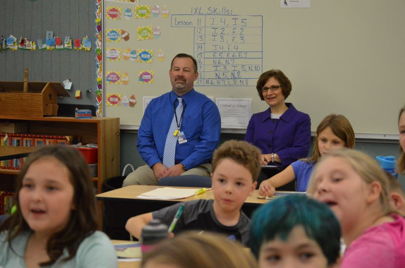 SPOTLIGHT PHOTO: NICOLE THILL - Lewis and Clark Elementary School Principal Dustin Salisbury and U.S. Rep. Suzanne Bonamici observe a classroom of third-grade students on Wednesday, Oct. 18. Bonamici visited the school to observe staff using a new program geared toward assessing student achievement in the classroom.