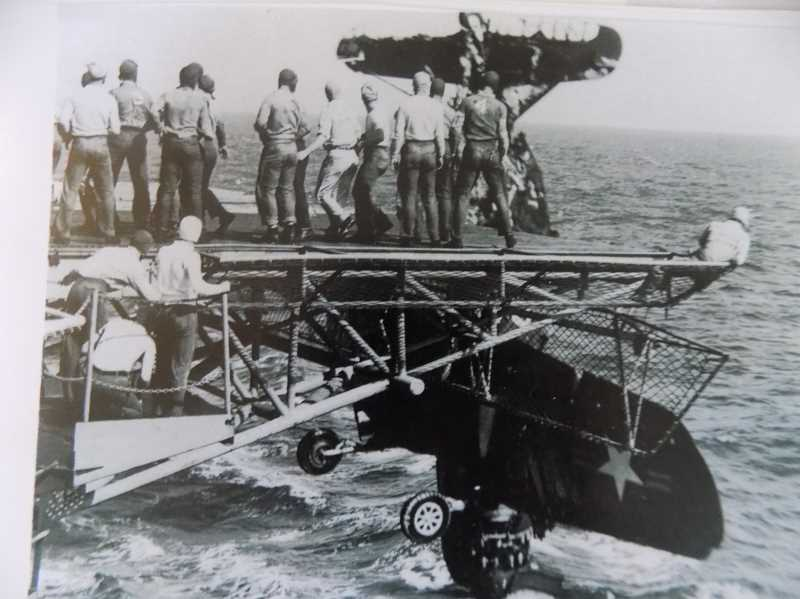 COURTESY RICK LOWRY - Rick Lowry received the wrong instruction as he tried to land on an aircraft carrier during WWII, where his tail hook cable broke and the aircraft's left wing hit the deck. His plane inverted before he started to slide off the deck with cables near an elevator platform catching him as the plane pointed downward to the open ocean. It took the crew 20 minutes to free him from the plane.