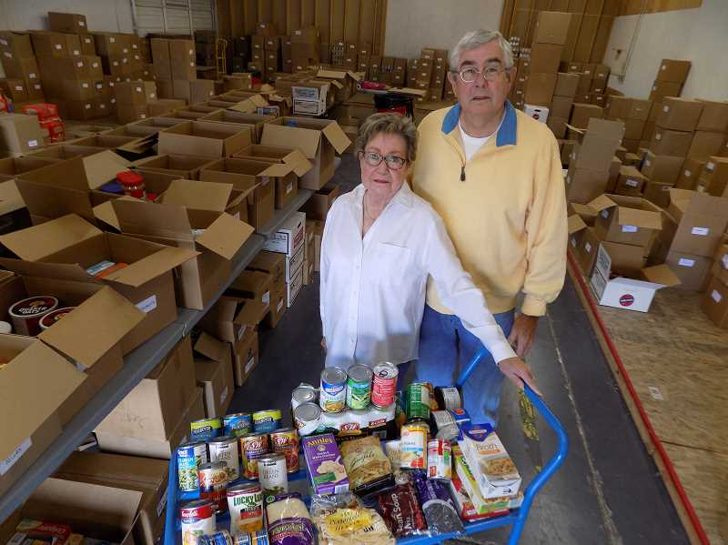 GAZETTE PHOTO: RAY PITZ - Gerry and Dottie Edy, who have worked with Helping Hands Food Pantry in one way or another for more than 16 years, are looking for warehouse space to replace the 2,100-square-foot warehouse Newberg warehouse shown here. The owner is selling this warehouse and the Edys hope to get a sweet deal on new space, ideally in Sherwood.