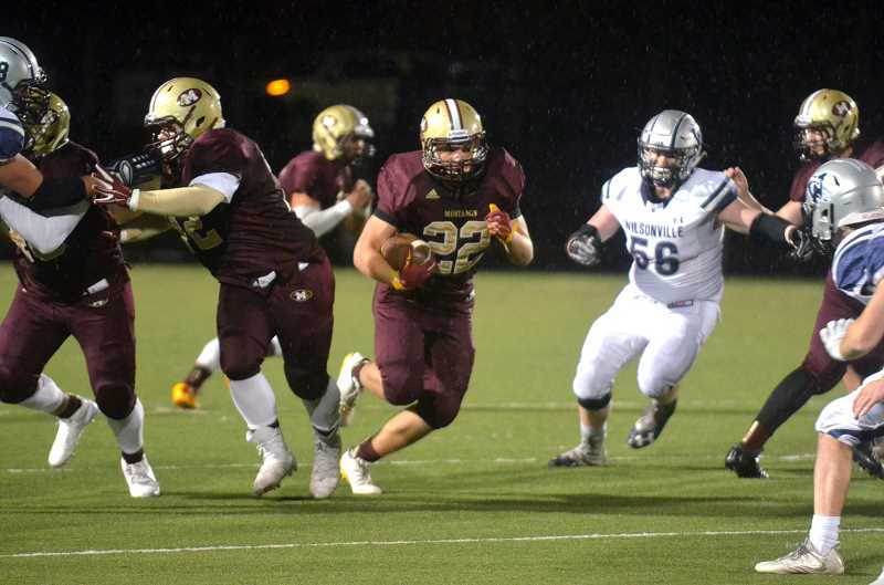 SPOKESMAN PHOTO: TANNER RUSS - Milwaukie senior running back Chazz Amundson was the Mustangs go to runner against the Wildcats. Wilsonville defeated Milwaukie 49-0 on Friday Oct. 20.