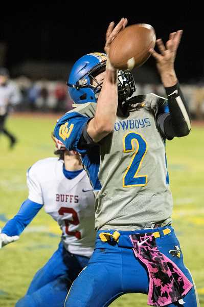 LON AUSTIN/CENTRAL OREGONIAN - Colton Burkhardt intercepts his second pass of the game as the Crook County Cowboys survive a late Madras White Buffalo rally to take a 25-21 win.