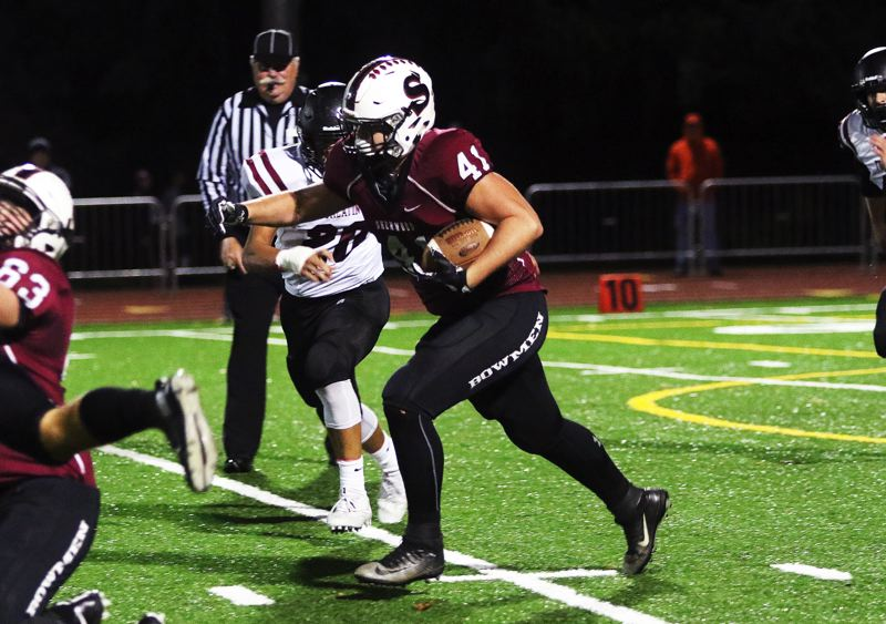 DAN BROOD - Sherwood senior tight end Sterling Goldstein heads up field after catching a pass in Friday's game.