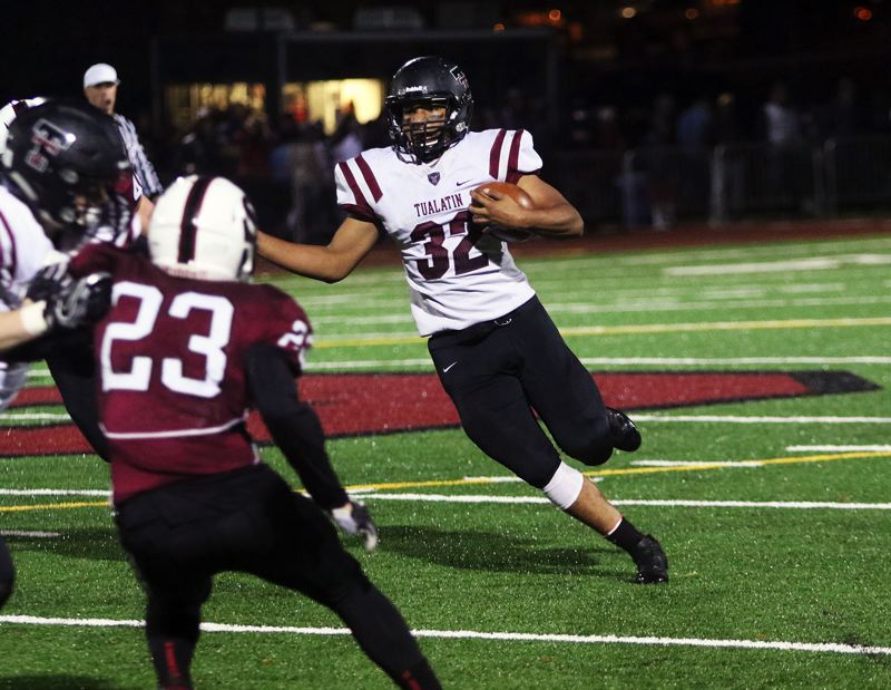 DAN BROOD - Tualatin junior Dominique Loggins heads up  field with the ball during Friday's game at Sherwood.