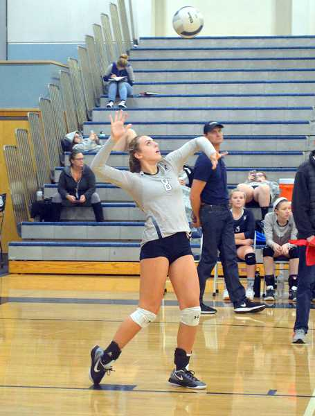 SPOKESMAN PHOTO: TANNER RUSS - Sophomore Tenley Lubisich had 11 straight serves to start the second set. Wilsonville defeated St. Helens 3-0 on Thursday, Oct. 19.