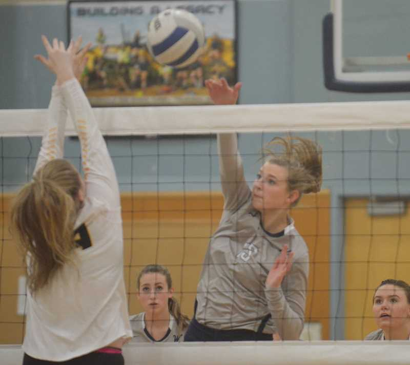 SPOKESMAN PHOTO: TANNER RUSS - Sophomore Lindsey Hartford slams the ball into St. Helens side of the court in Wilsonvilles three set domination on Thursday Oct. 19.