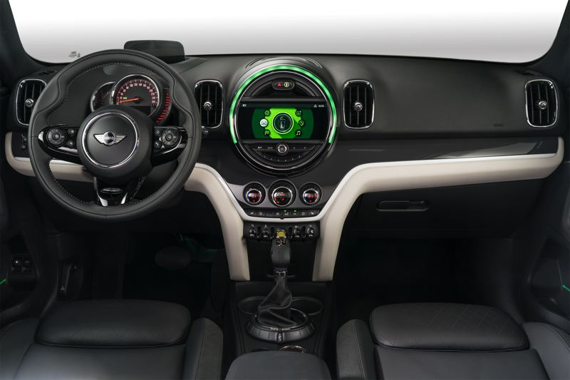 BMW OF NORTH AMERICA - Although updated for 2018, the dash of the  Cooper S E Countryman ALL4 retains most of Mini's trademark touches, including the circular dash and mix of conventional buttons and toggle switches.