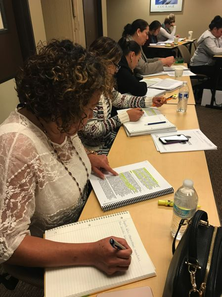SUBMITTED PHOTO: DAWN HENDRICKS - Spanish speaking students pour through coursework to receive Early Childhood Education college credits.