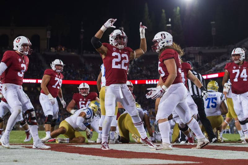 COURTESY: STANFORDPHOTO.COM - Cameron Scarlett (22), from Central Catholic High, has a big week ahead, playing against Oregon State in Corvallis on Thursday and then going to Seattle to watch his brother, Brennan, playing for the Houston Texans against the Seahawks on Sunday.