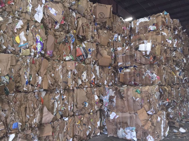 COURTESY FAR WEST RECYCLING  - Bales of cardboard await shipment at Far West Recycling's Hillsboro plant.