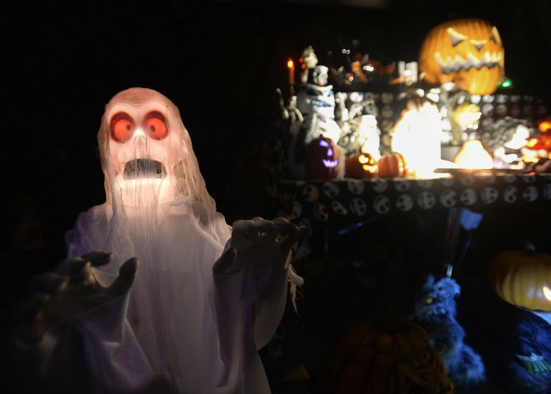 OUTLOOK PHOTO: JOSH KULLA - Karen Olsen and Scott Tangen's Pumpkin Acres features a darker sense of humor and plenty of LED-lit ghosts and ghouls.