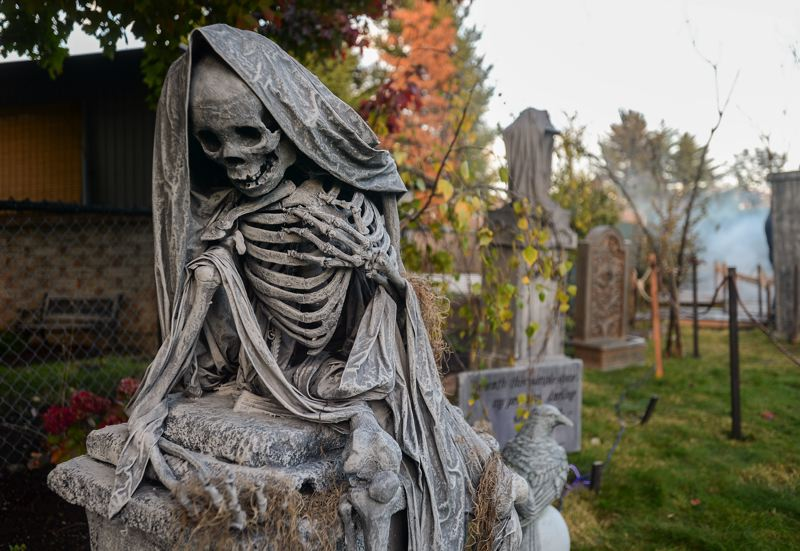 OUTLOOK PHOTO: JOSH KULLA - These Dante-esque skeletons are a trademark of Becky Newman's Witch Creek Cemetery Halloween display.