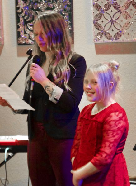 OUTLOOK PHOTO: CHRISTOPHER KEIZUR - Nine-year-old mentee Ava spoke during the event alongside her mentor, Erika Michaud.