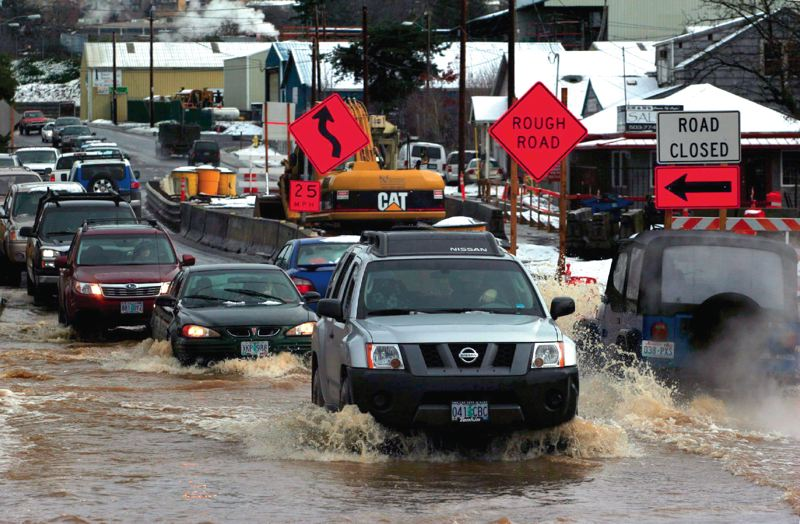 TRIBUNE PHOTO: JONATHAN HOUSE - Flooded streets are more likely under climate change and will make it harder for students to get to school, leading to the possibility of more unexpected school closures.