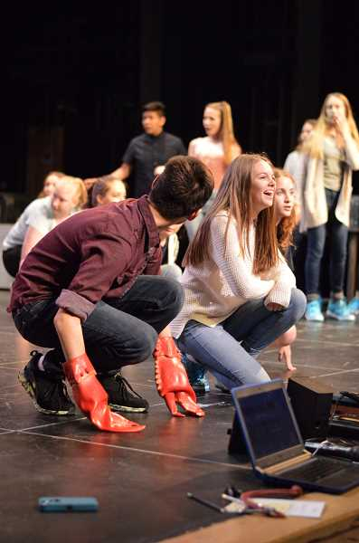 SPOKESMAN PHOTO: CLARA HOWELL - Freshmen Corcmac Lister (left), Kate Jeffries (middle) and Hailey Flick (right) enjoy rehearsal weeks before opening night.