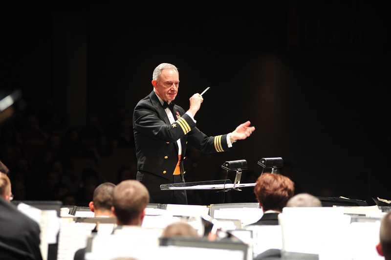 COURTESY OREGON SYMPHONIC BAND - The award-winning Oregon Symphonic Band is conducted by Michael Burch-Pesses, former U.S. Navy bandmaster (shown leading that band here) and current director of bands at Pacific University.  The concert features music