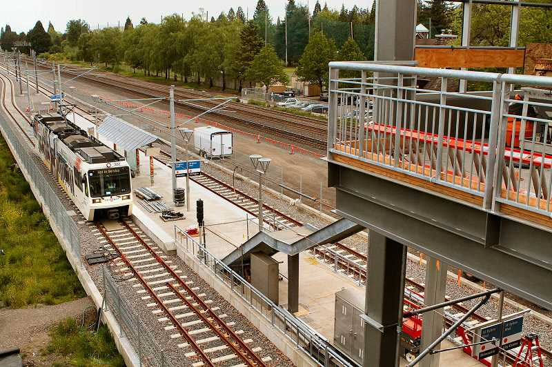 FILE PHOTO - Red Line expansion would mean riders could take a single train from Hillsboro at the fair complex to Portland International Airport. The trip currently requires changing trains.
