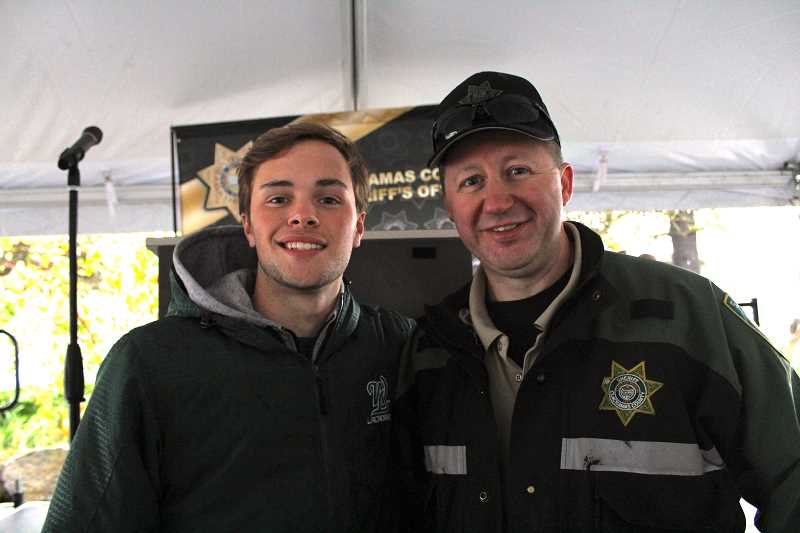 REVIEW PHOTO: SAM STITES - Michael Stell of West Linn poses for a photo with Deputy Bryon ONeill after hearing a presentation about the dangers of driving at high speeds.