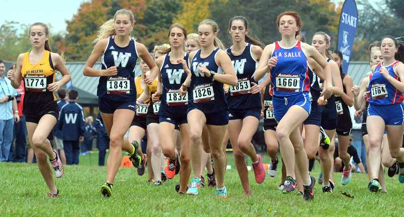 SPOKESMAN PHOTO: TANNER RUSS - Wilsonville sophomore Samantha Prusse at the start of the girls varsity race at the district meet on Oct. 25.
