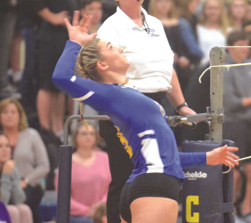 HERALD PHOTO: TANNER RUSS - Barlow senior Megan Sester goes up for a kill against Canby. The Bruins defeated the Cougars 3-2 on Oct. 25 in the first round of the playoffs.