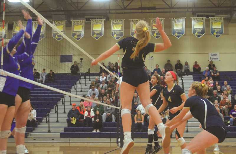 HERALD PHOTO: TANNER RUSS - Canby senior Diana Krishchenko goes up to spike the ball onto the Barlow side of the court. Canby lost to the visiting Bruins in the first round of the playoffs on Oct. 25.